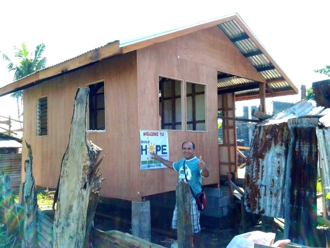 Ptr Joel. with one of the BuildHope Houses.
